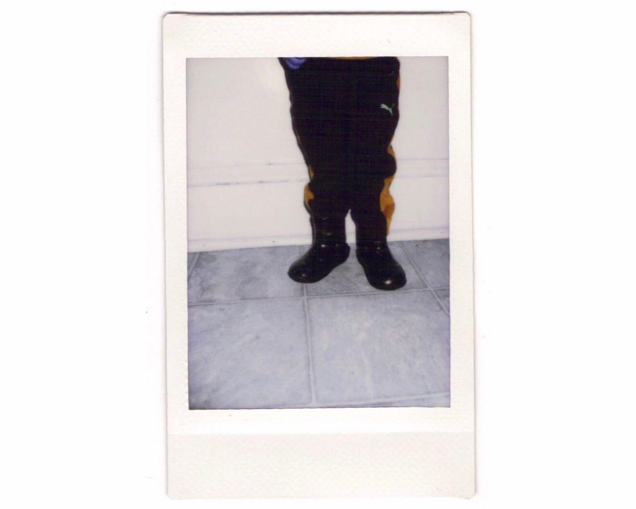 "day 22 - I taught Alejandro how to say ""boots"" the other day, and he's obsessed with these little rain boots. He wears them every day, and gets mad when somebody takes them off 👶🏽😂 Instant Photo A Day Black Color Film Photography Fujifilm Fuji Instax Film One Person Real People Indoors  White Background Human Body Part Human Leg Day People"