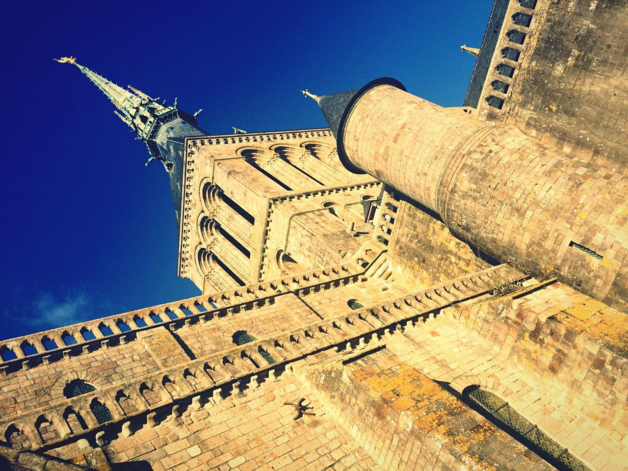 Architecture Built Structure Low Angle View History Blue Sunlight Outdoors No People Clear Sky Day Sky Ancient Mont Saint-Michel France