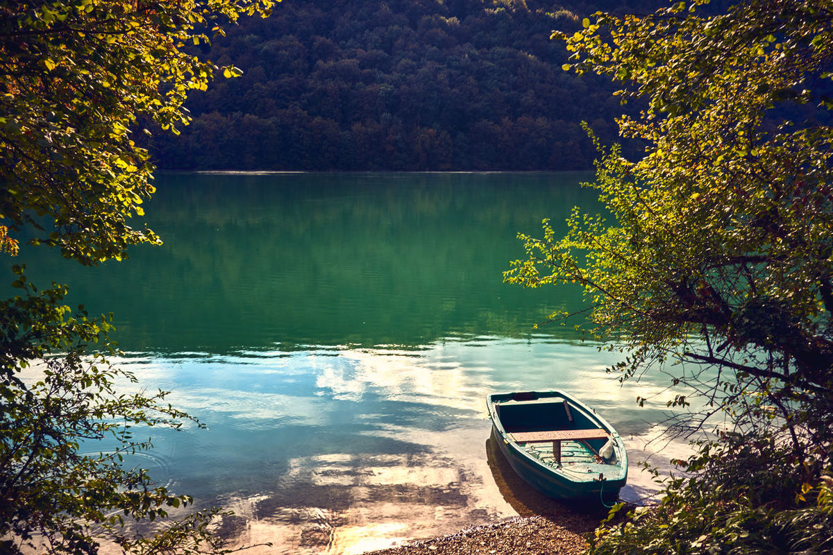 Tranquility Beauty In Nature Boat Forest Lake Landscape Nature Nautical Vessel No People Outdoors Reflection Scenics Tree Water