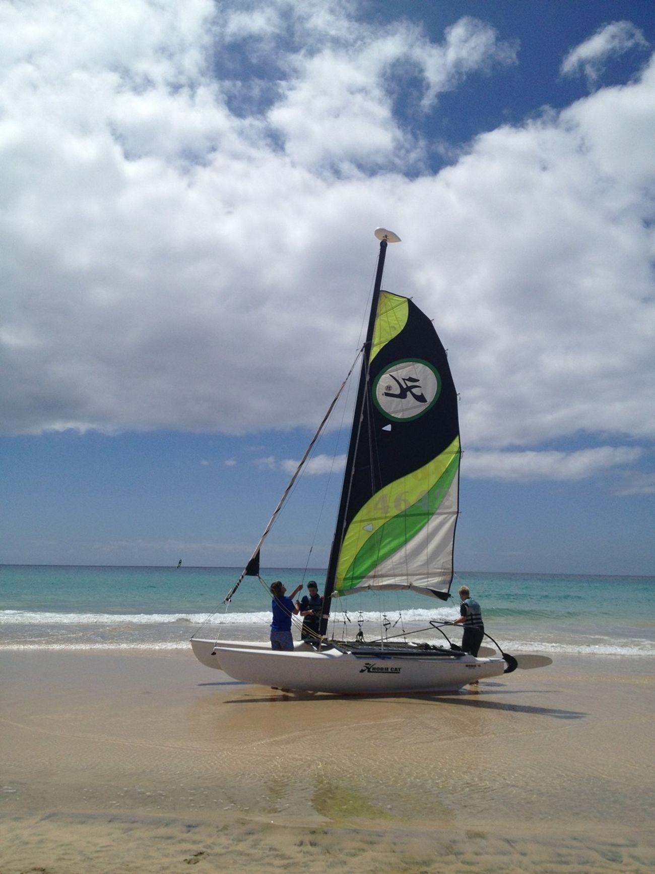 Enjoying The Sun Catamaran From The Sea