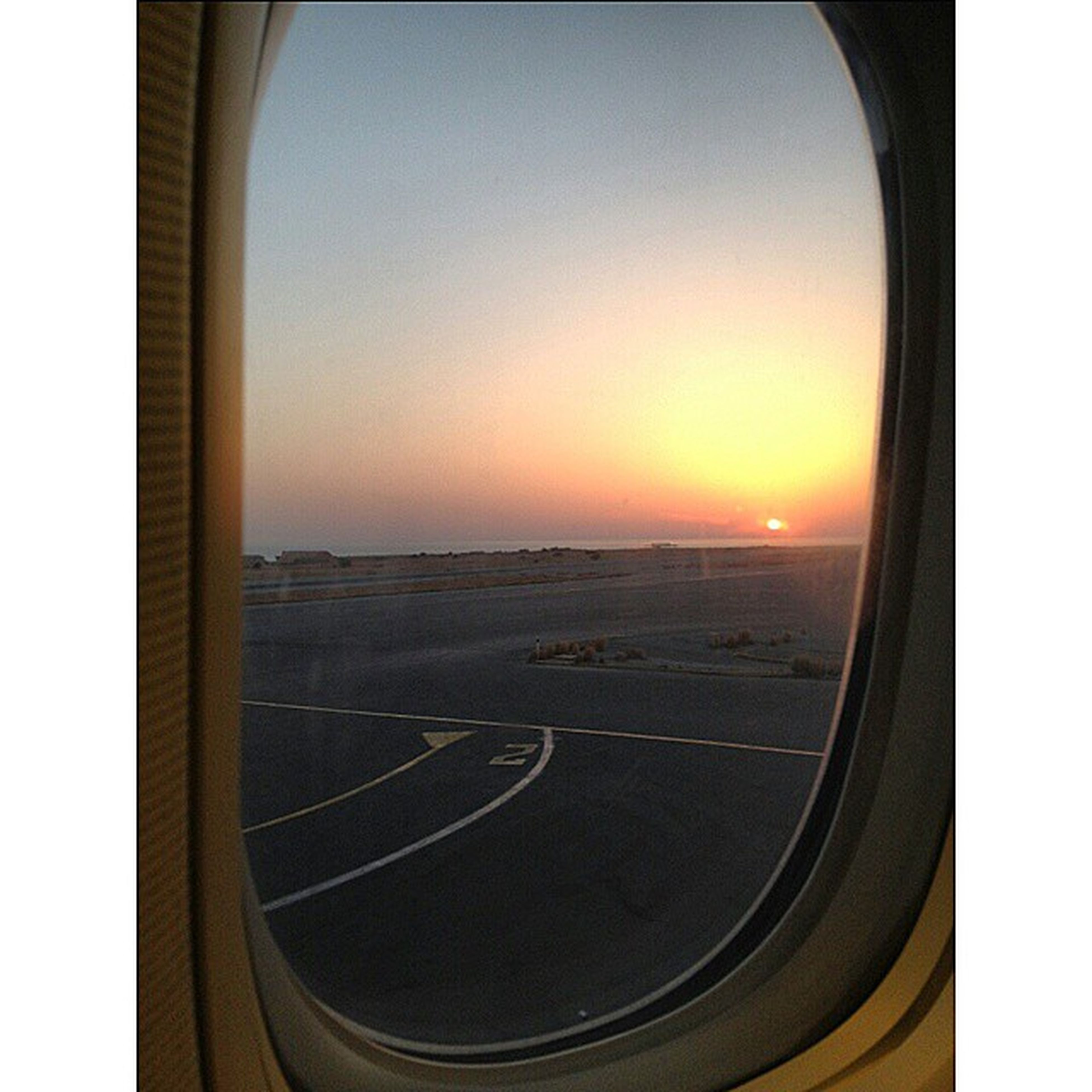 sunset, transportation, orange color, sun, clear sky, scenics, mode of transport, window, vehicle interior, copy space, beauty in nature, airplane, glass - material, sky, transparent, nature, travel, tranquility, tranquil scene, sea