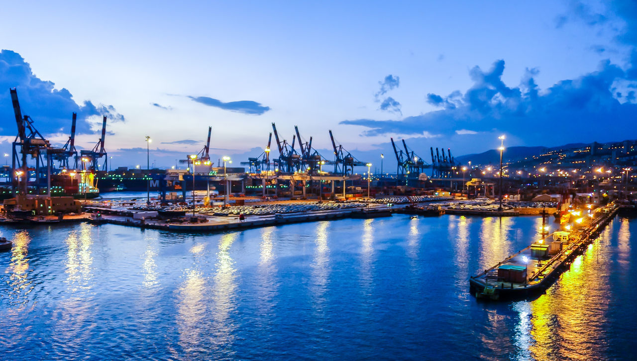 Architecture Building Exterior Built Structure City Cloud - Sky Commercial Dock Crane - Construction Machinery Freight Transportation Harbor Illuminated Industry Mode Of Transport Moored Nautical Vessel Night No People Outdoors Reflection Sea Shipping  Shipyard Sky Transportation Water Waterfront