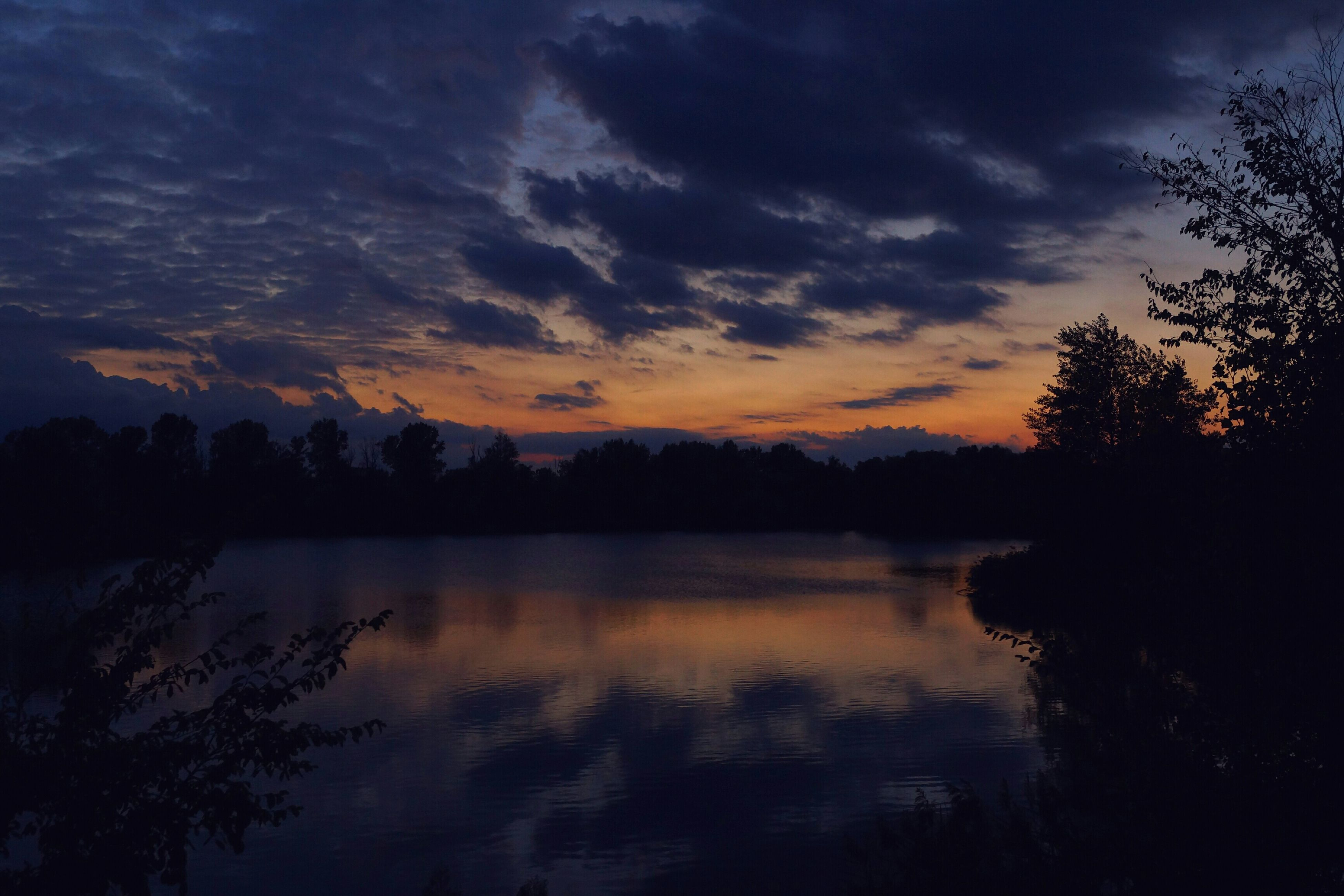 sunset, tranquil scene, scenics, tranquility, sky, water, beauty in nature, tree, silhouette, reflection, lake, cloud - sky, nature, idyllic, cloud, orange color, waterfront, calm, river, dusk