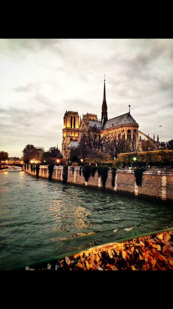 architecture, water, built structure, sky, building exterior, history, cloud - sky, tourism, no people, waterfront, travel destinations, river, outdoors, castle, day, city, nature