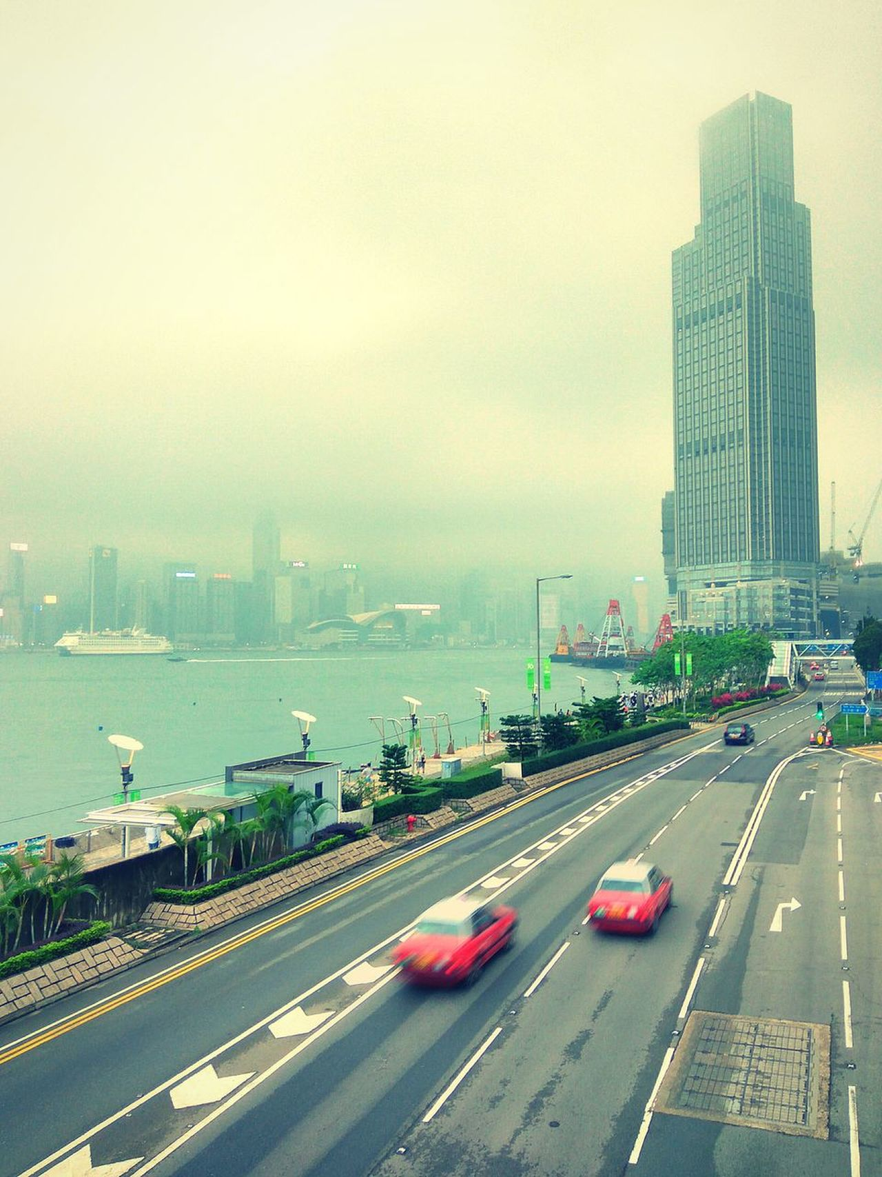 HongKong Hunghom Road HongKong Taxi Red Taxi Clouds Hongkong Island City Downtown District Skyscraper Traffic Urban Skyline Environment The Street Photographer - 2017 EyeEm Awards high angle view Day City Life Business Finance And Industry Building Exterior Transportation Car Accidents And Disasters Storm Cloud Modern Cityscape