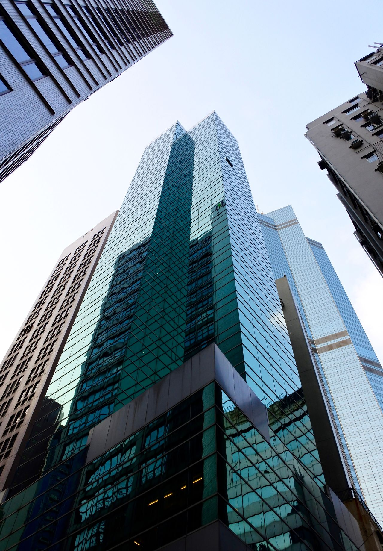 Architecture Building Exterior Building Reflections Built Structure Business EyeEm Best Shots Financial District  Glass - Material Glass Building Glass Reflections Glass Skyscraper Hong Kong Hong Kong Architecture Hong Kong Building Hong Kong Skyscraper Low Angle View Modern Office Building Skyscraper Skyscrapers Tall - High Tall Buildings Tower The City Light Minimalist Architecture