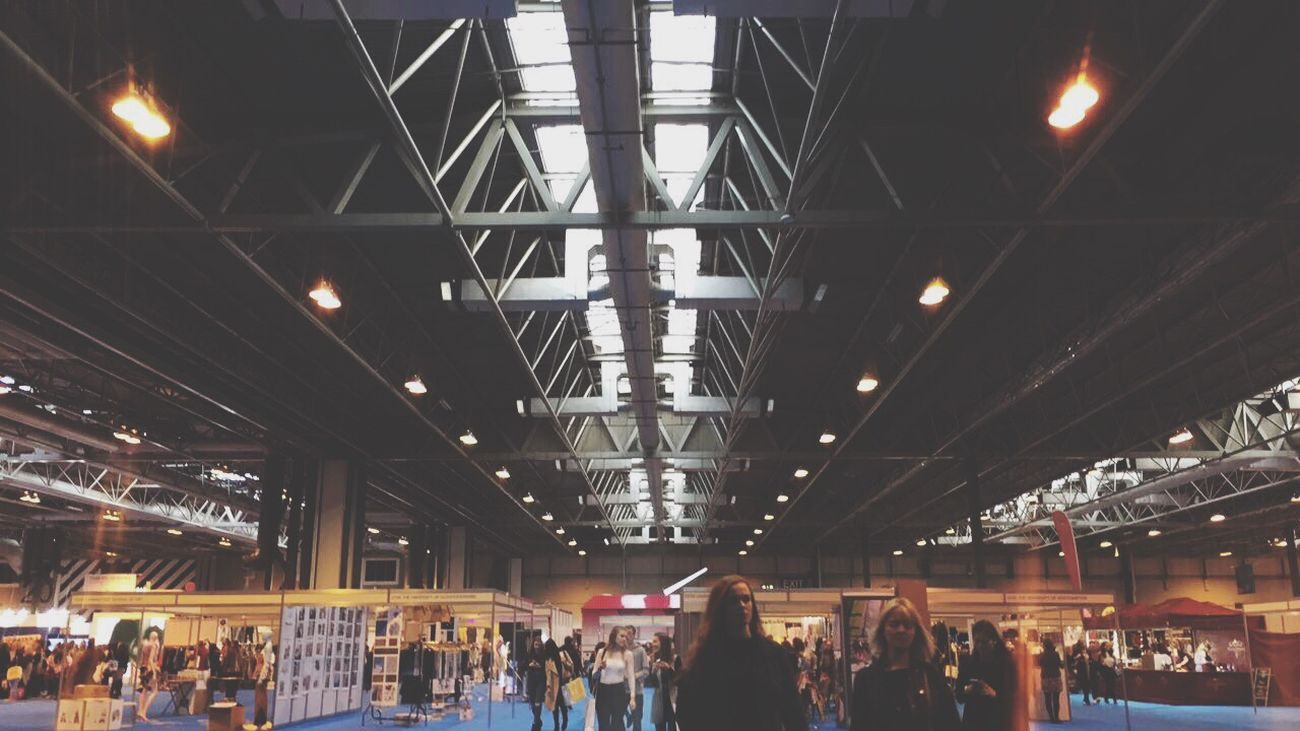 Illuminated Ceiling Lighting Equipment Large Group Of People Indoors  Railroad Station Crowd Men Real People Night People