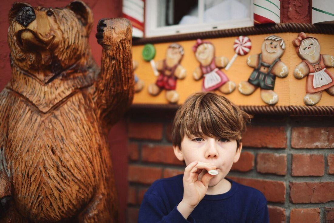 A 10 Years Old boy takes a Sugar break outside the local Candy Store . Chemainus British Columbia Canada