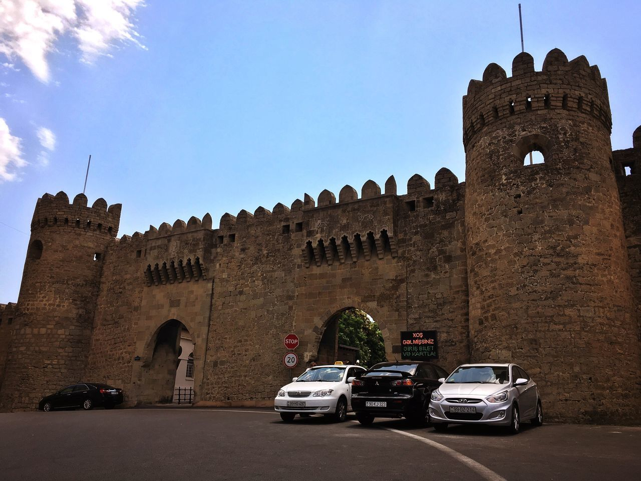 Cars are parked near the double gate of Baku's Old City, Incherisheher in Azerbaijan Historical Building Baku Azerbaijan Traveling Building Architecture