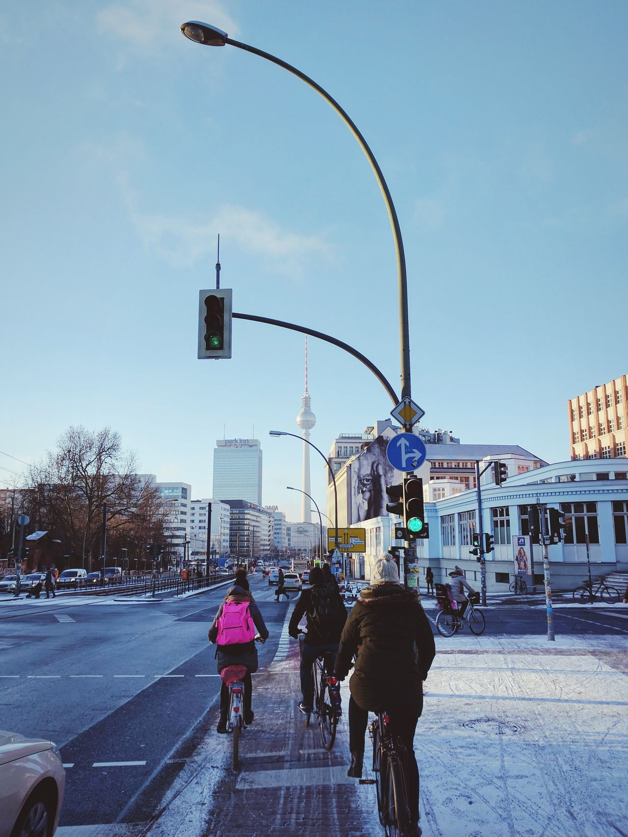 Commuting Commute Winterscapes City Ferris Wheel Outdoors Adults Only People Day Adult Urban Road One Person Cultures Sky Architecture Alexanderplatz Fernsehturm Berlin Biking Bikers Bike Ride Or Die Ride Vanishing Point Berliner Ansichten