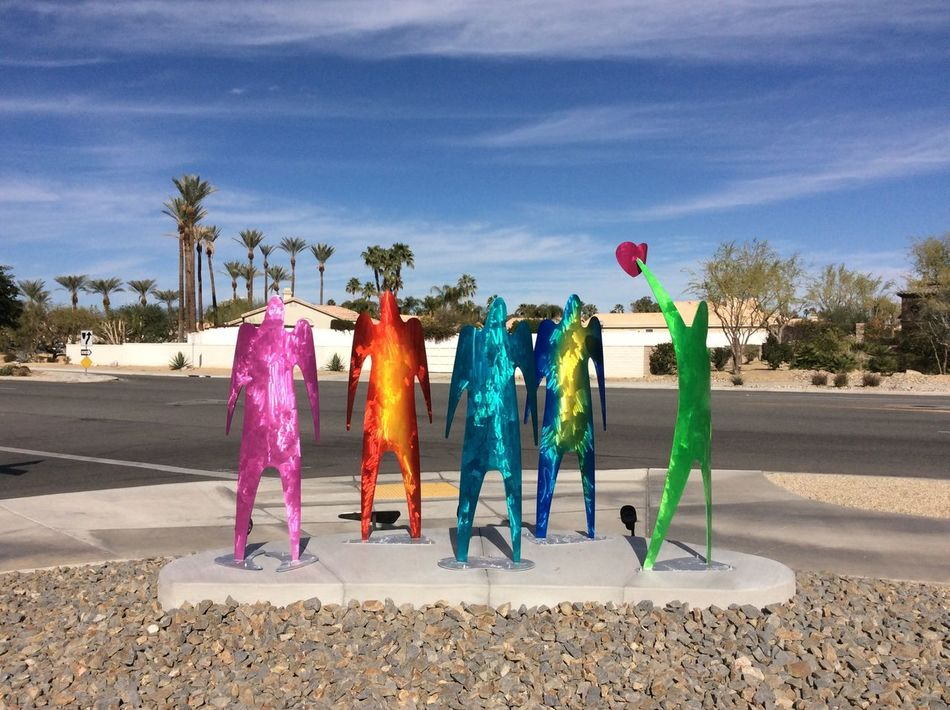 From My Point Of View Morning Sun Feb 2016 USA Blue Sky Public Art Space Age Figures Roadside steel human figures Red Heart pebbles Palm Springs CA. Palm trees I-pad Photography California