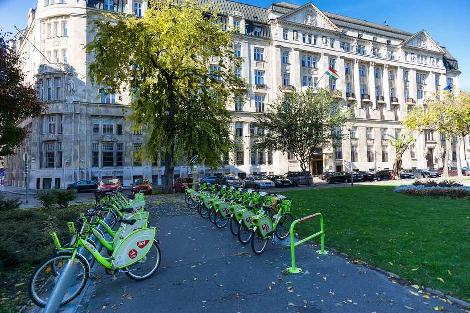 Budapest, Hungary Architecture Bicycle Budapest Building Building Exterior Built Structure City Day Grass Green Color Growth House Land Vehicle Lawn Mode Of Transport Parliament Plant Rental Bikes. Residential Building Residential Structure Street Transportation Tree
