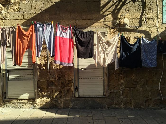 Clothes are drying outside the house in Acre, Isrel Acre Clothes Clothing Domestic Life Dry Hanging Israel Life No People Street
