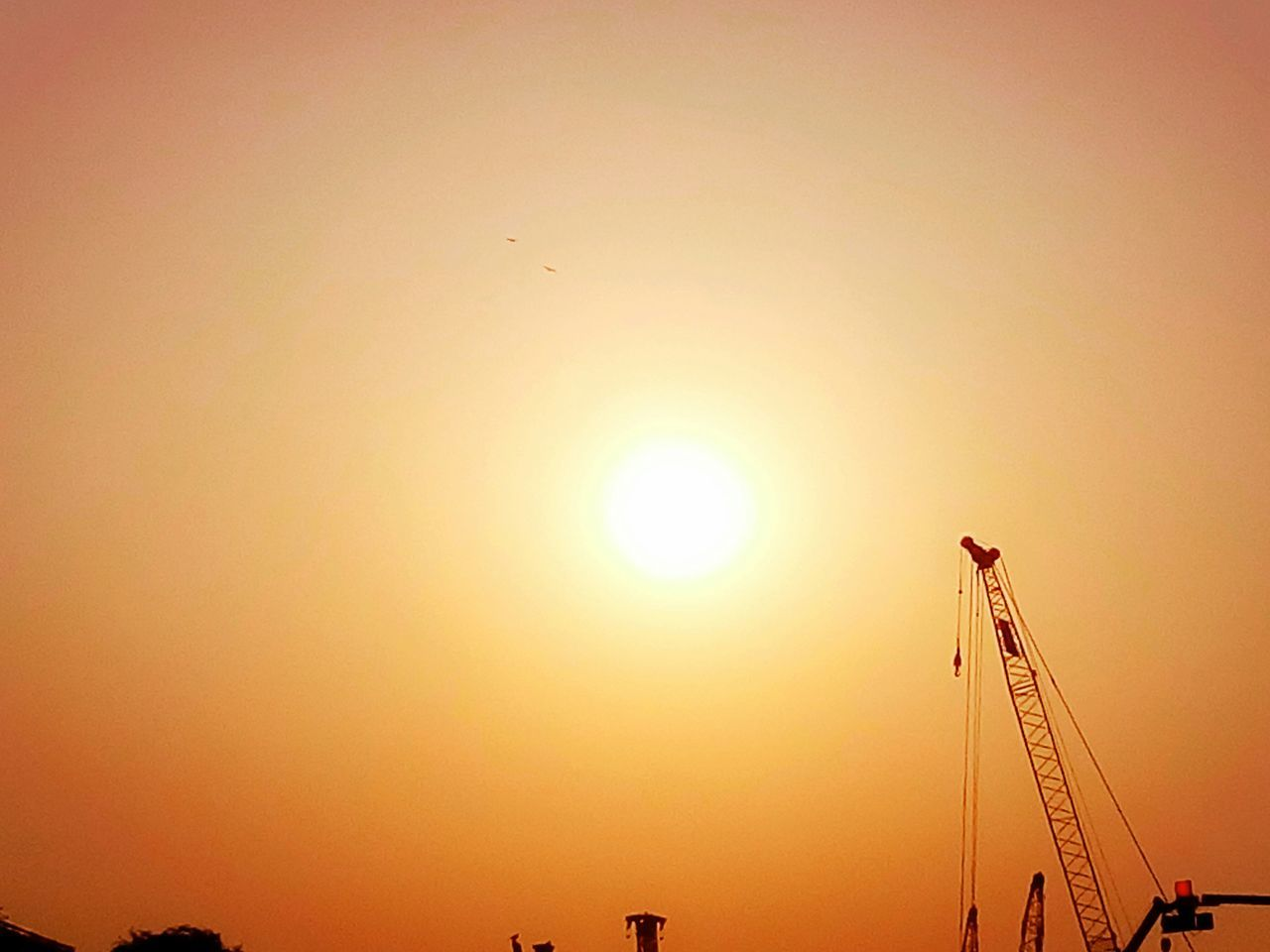 sunset, sun, orange color, sunlight, development, silhouette, outdoors, sky, no people, crane, nature, low angle view, beauty in nature, architecture, scenics, progress, clear sky, industry, day