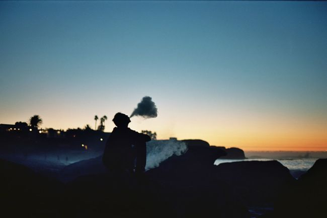 Shot on 35mm film using Ektar 100 and then scared to digital Beauty In Nature Blue Clear Sky Dusk Film Photography Horizon Over Water Leisure Activity Lifestyles Nature Outdoors Outline Relaxation Rock - Object Scenics Sea Shore Silhouette Sky Sunset The Great Outdoors - 2016 EyeEm Awards The Street Photographer - 2016 EyeEm Awards Tranquil Scene Tranquility Unrecognizable Person Water