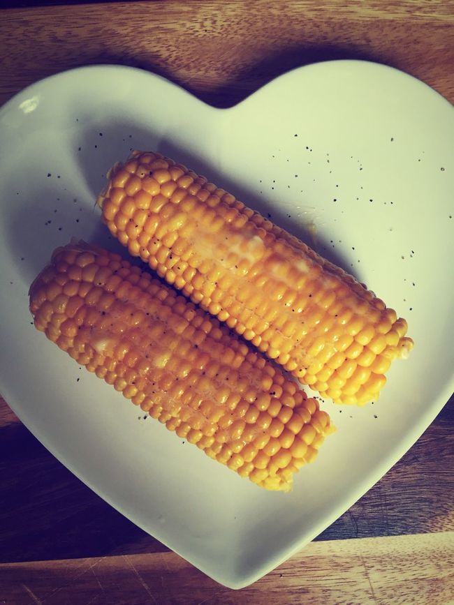 Sweetcorn Food And Drink Food Indoors  Close-up Freshness Still Life Preparing Food Preparation  Healthy Eating Cooked Ready-to-eat Meal Corn Plate Overhead View Appetizer Indulgence In A Row Temptation Homemade Butter Pepper On A Plate Heart Shape White Plate
