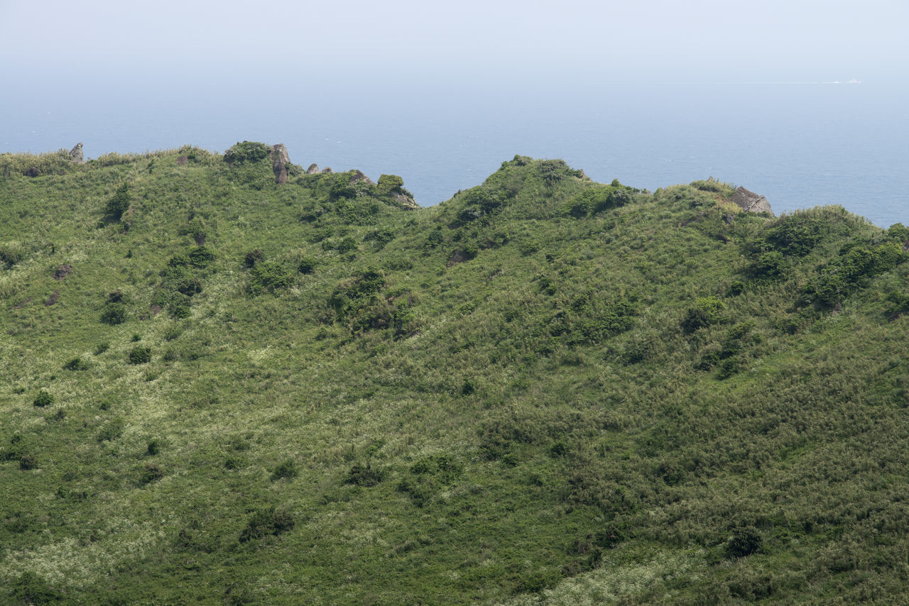 Scenic View Of Mountain Against Sky At Seongsan Ilchulbong On Jeju Island