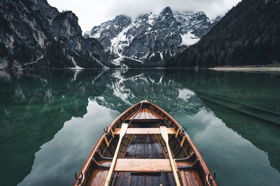 Best paddling place. Italy Mountain Lake Water Nature Scenics Beauty In Nature Nautical Vessel Reflection Travel Destinations Canoe Tranquility Ship's Bow Tranquil Scene Tourism Outdoors Mountain Range Kayak Landscape Snow No People
