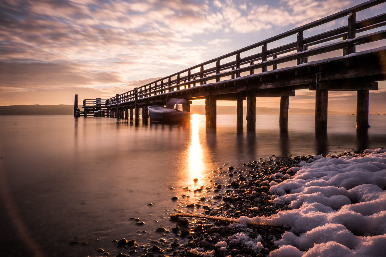 morning glory Architectural Column Architecture Beauty In Nature Bridge Bridge - Man Made Structure Built Structure Cloud - Sky Connection Engineering Nature No People Orange Color Outdoors Pebble Pier Reflection River Scenics Sea Sky Standing Water Sun Sunset Tranquil Scene Water