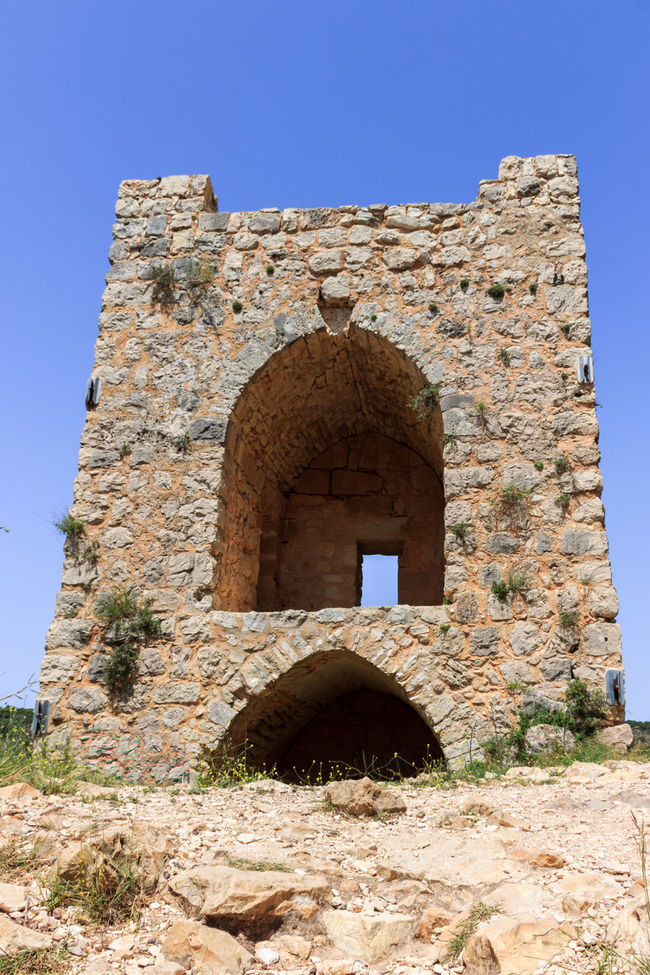 Watchtower, the remains of outer walls of castle Monfort in northern Israel, and the path leading to the castle Ancient Architecture Architecture Built Structure Castle Crusaders Cultures Famous Fort History Israel Leading Medieval Monfort Old Old Ruin Outer Remains Ruined Stone The Past Tourism Tower Travel Destinations Watchtower