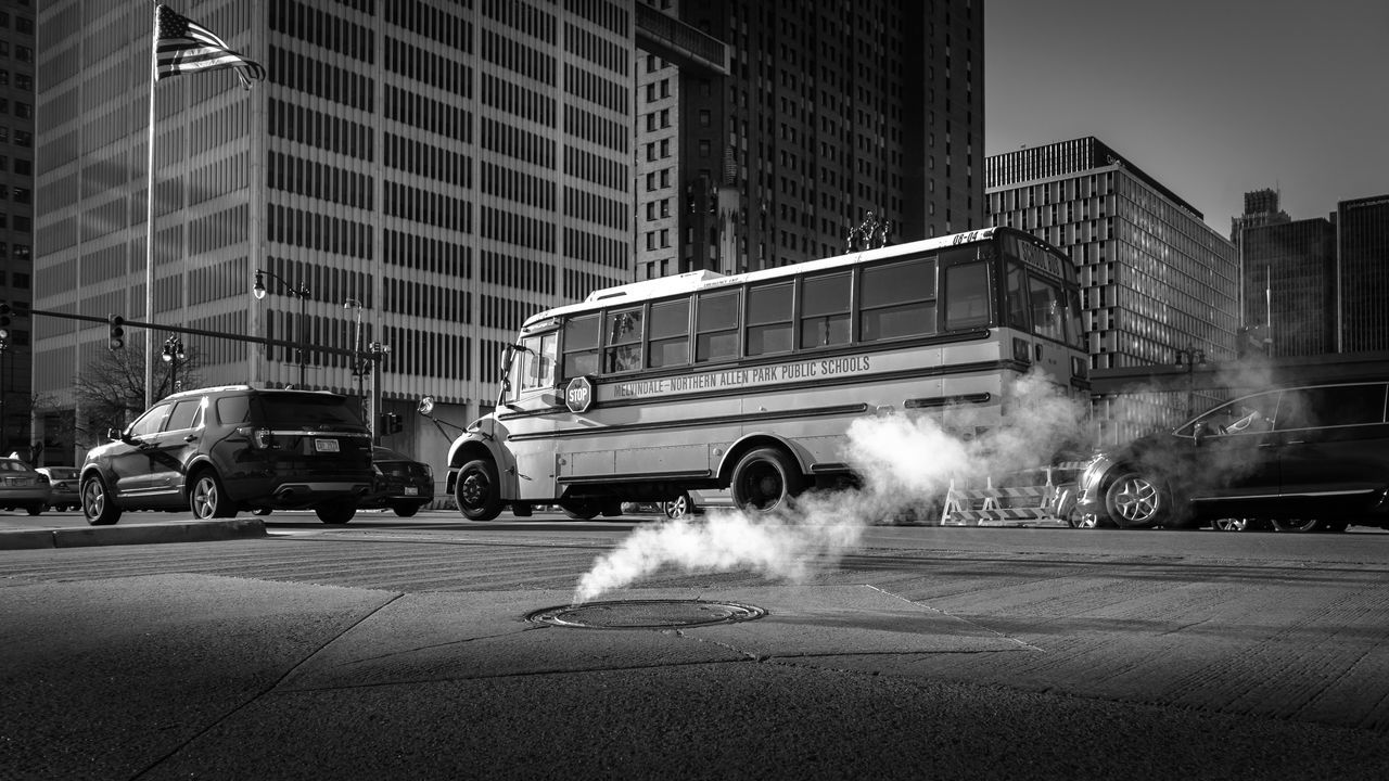 Streets of Detroit | #SPBLOG Architecture Black & White Black And White Blackandwhite Bus Canonboyz Canonm5 Car City Detroit Low Angle View Monochrome Monochrome Photography Smoke Smoke - Physical Structure Speed Street Street Photography Streetphoto_bw Streetphotography The Street Photographer - 2017 EyeEm Awards