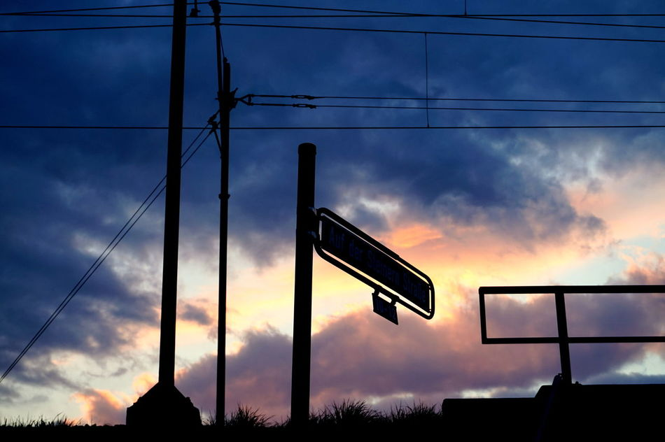 Cloud - Sky Silhouette Sunset Sky Outdoors No People Day Streetsign Streetsigns Clouds Dawn Electricity  Electricity Lines
