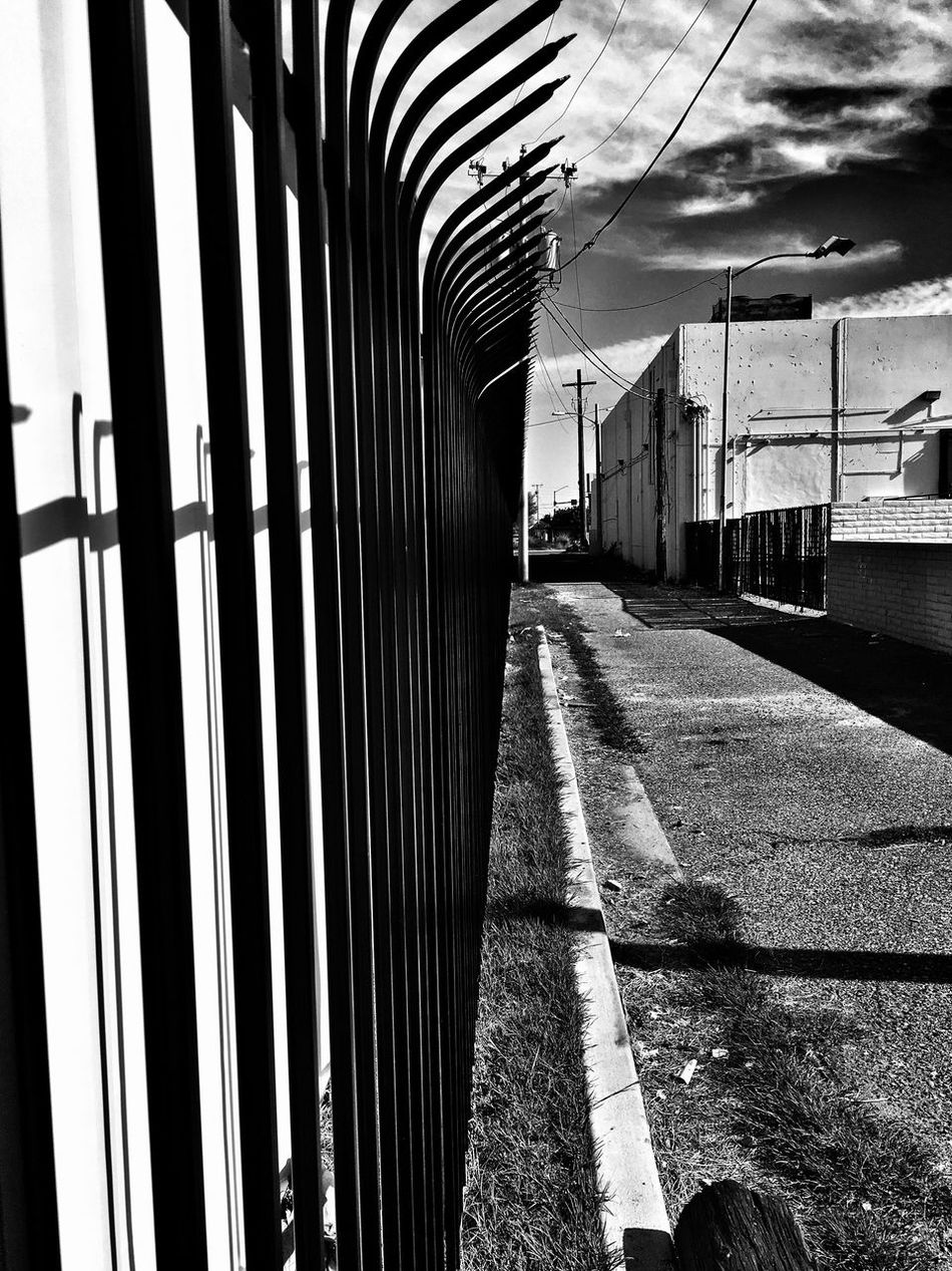 Gate The Way Forward No People Day Outdoors Architecture Sky Gate Alley Phoenix, AZ EyeEm Gallery Check This Out Popular Photos Alleyway Alleyezonmayphotography Black And White Photography