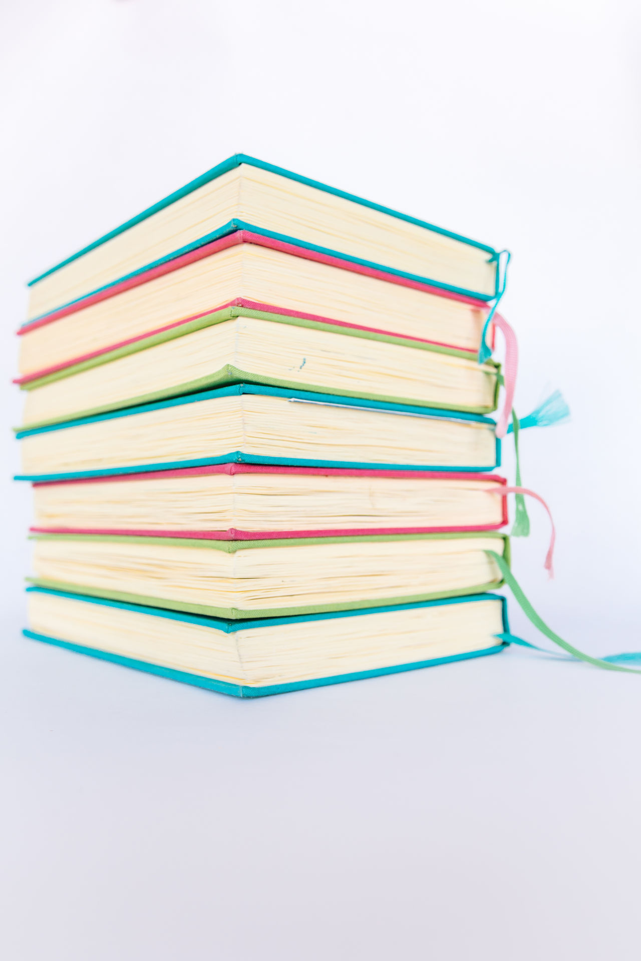 Colorful Books Blue Books Colorful Colors Cyan Education Educational Green Learning LearningEveryday Multi Colored No People Paper Pink Reading Reading Books Reading Time Stack Studio Shot Study Hard Study Time Studying White Background