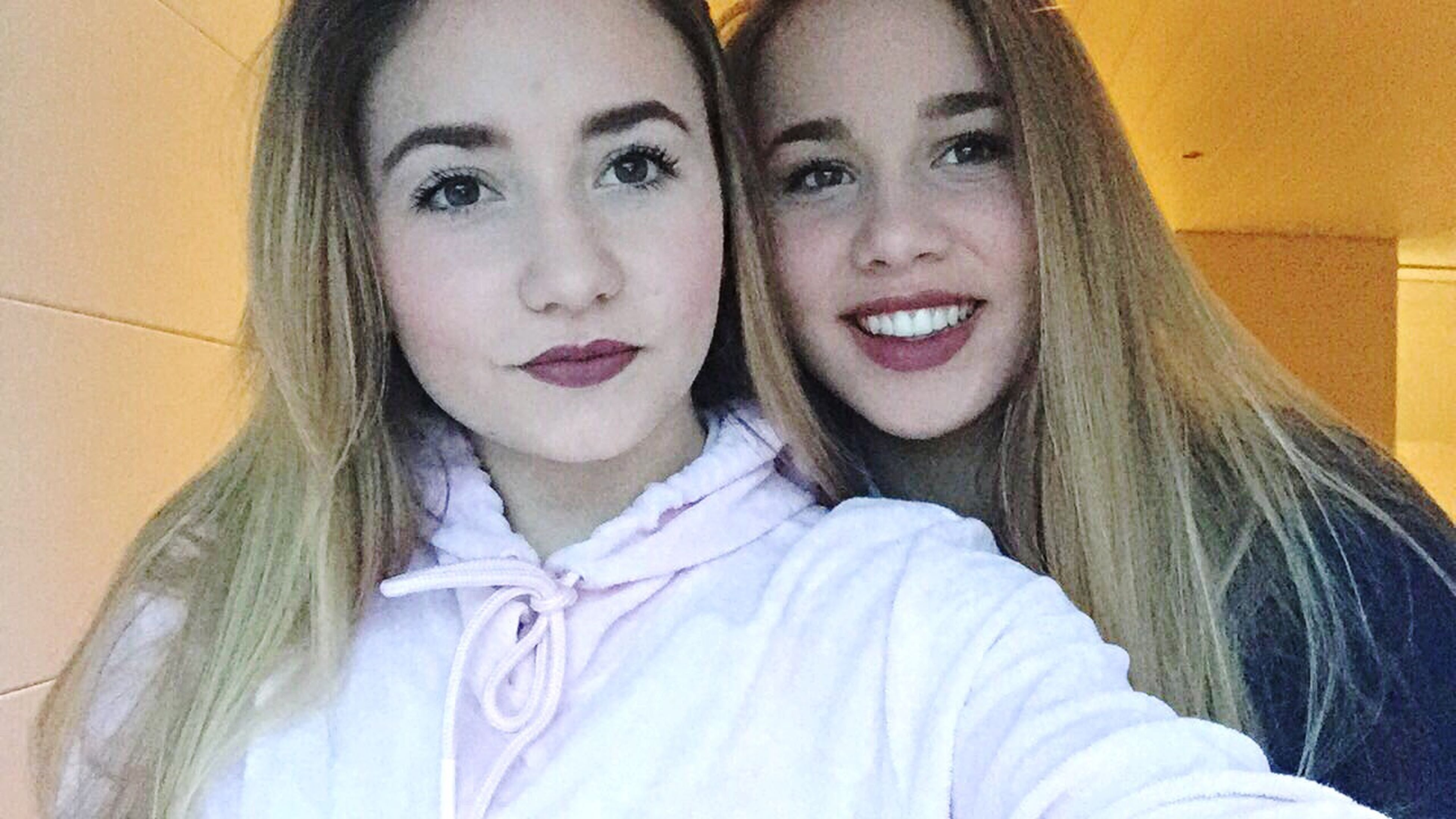 two people, looking at camera, portrait, headshot, togetherness, friendship, happiness, adults only, young adult, young women, blond hair, women, real people, adult, only women, beautiful woman, close-up, people, smiling, day, outdoors