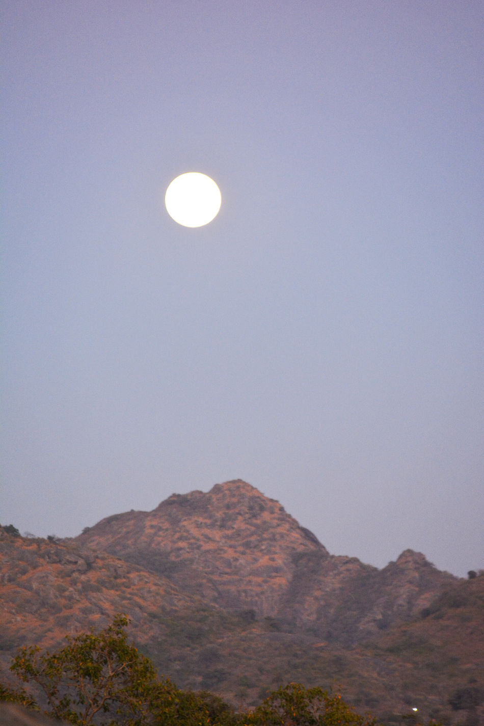 Full moon at 4003ft above from sea level!!! Took it at Mount Abu famous hill station at India the beauty is went to see sunset and immediately after sun down moon appears !!! Full Moon Moon At Sunset Experimental Photography Travel Photography Mount Abu Rajasthan, India MOUNT ABU SUNSET Glowing Outdoors Low Angle View New Life