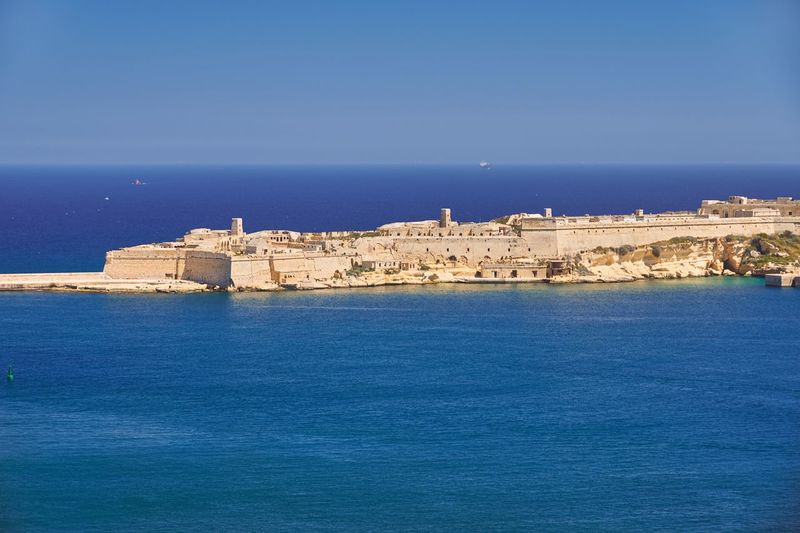 Grand Harbour and Fort St Angelo, Malta Malta Grand Harbour Harbor Water Sea Mediterranean  Turquoise Blue Sky Fortress Fort No People Horizon Over Water Built Structure Nature Outdoors Blue Waterfront Scenics Architecture Historic Historical Building Tranquil Tranquil Scene