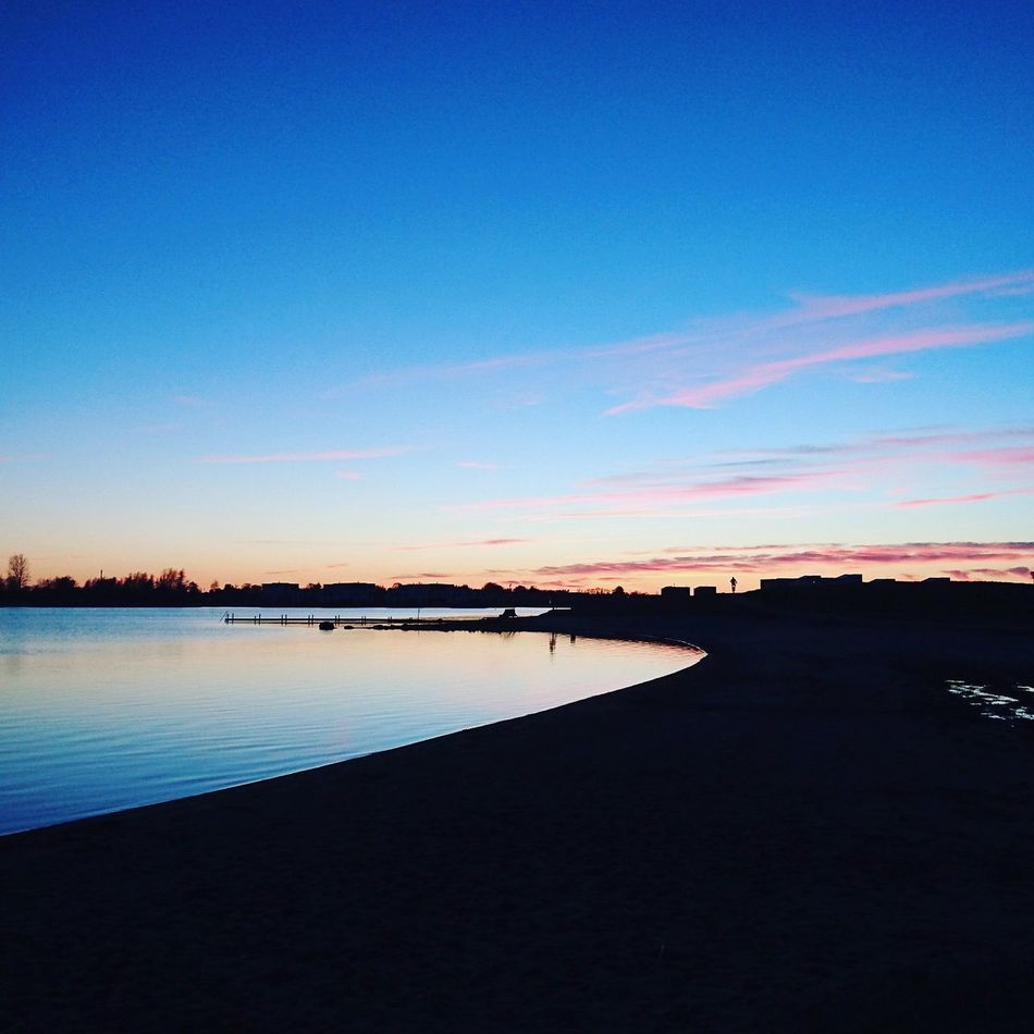 An evening walk by the lake enjoying the sunset Reflection Lake Water Nature Blue Beauty In Nature Sky Horizon Over Water Outdoors Tree No People Astronomy Astrology Sign Day Sunset Evening Walk
