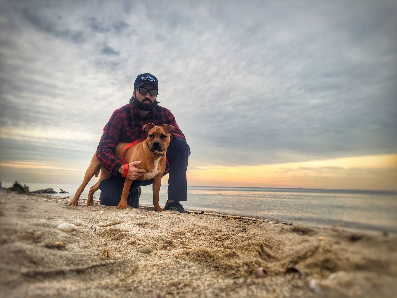 dog, sea, pets, beach, sunset, one animal, horizon over water, sand, nature, real people, outdoors, men, sky, water, domestic animals, happiness, full length, bonding, friendship, beauty in nature, mammal, one person, day, adult, people