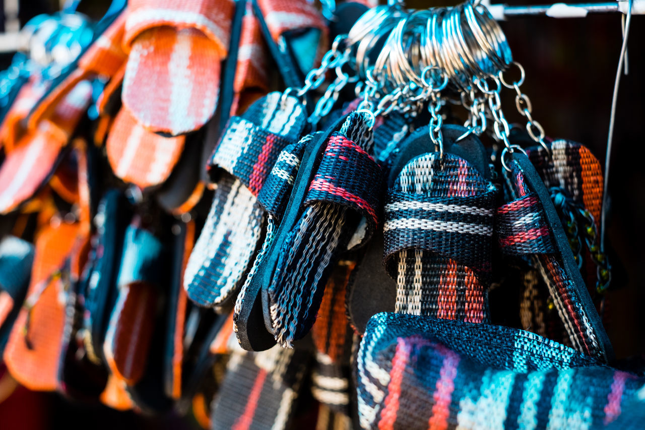 Handmade key chains of miniature T'nalak (abaca) slipper Abaca Black Choice Close-up Day Display Fabric Focus On Foreground For Sale Hanging Indoors  Key Chain Large Group Of Objects Market Market Stall Multi Colored Native Product No People Pattern Red Retail  Slipper  T'boli T'nalak