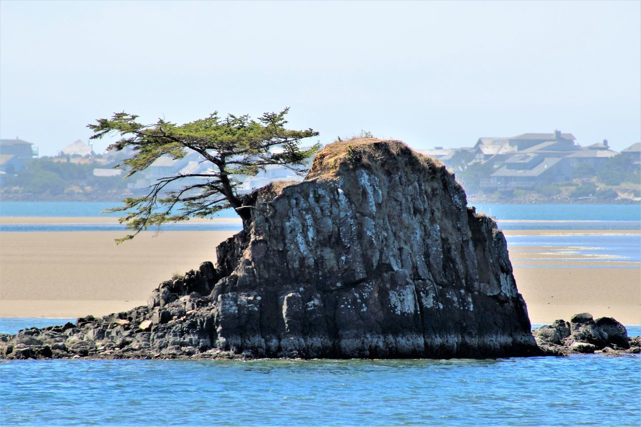 nature, sea, beauty in nature, scenics, water, tranquility, tranquil scene, sky, tree, rock - object, no people, outdoors, day, horizon over water, beach, mountain, clear sky