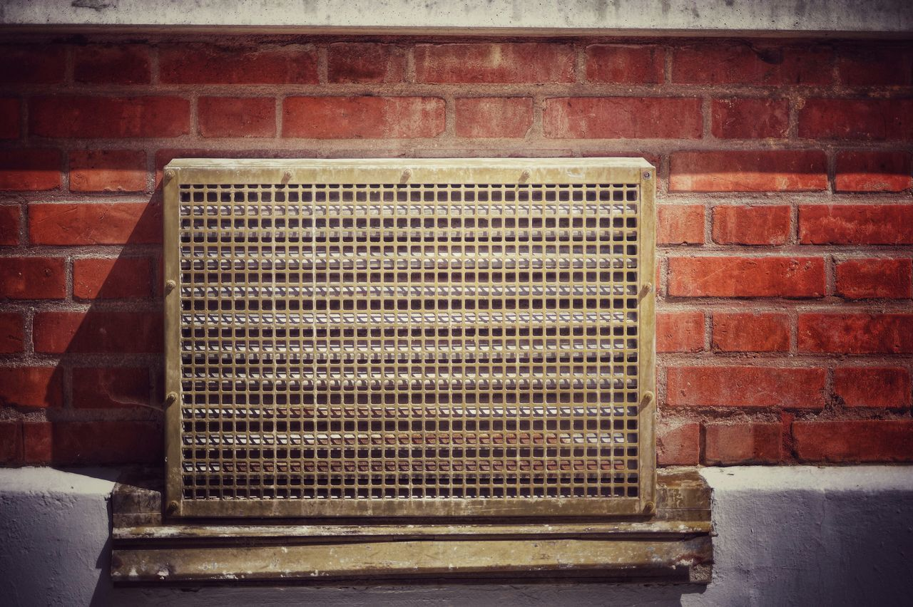 Close-Up Of Air Duct On Brick Wall