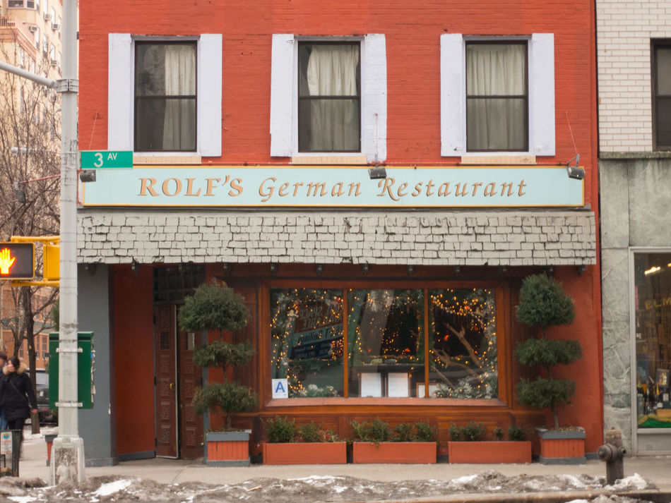 NEW YORK CITY - 2 FEBRUARY 2015: Exterior of Rolf's German Restaurant in Manhattan. Known for its Schwarzwald Christmas decorations Topiary trees out front with a wood shingled roof. Architecture Bar Building Exterior Day Exterior Exterior Building Faa Famous Place Food And Drink German Restaurant Lifestyle New York City NYC Street Outdoors Pub Restaurants Rolf Rolf's German Restaurant Tree Window