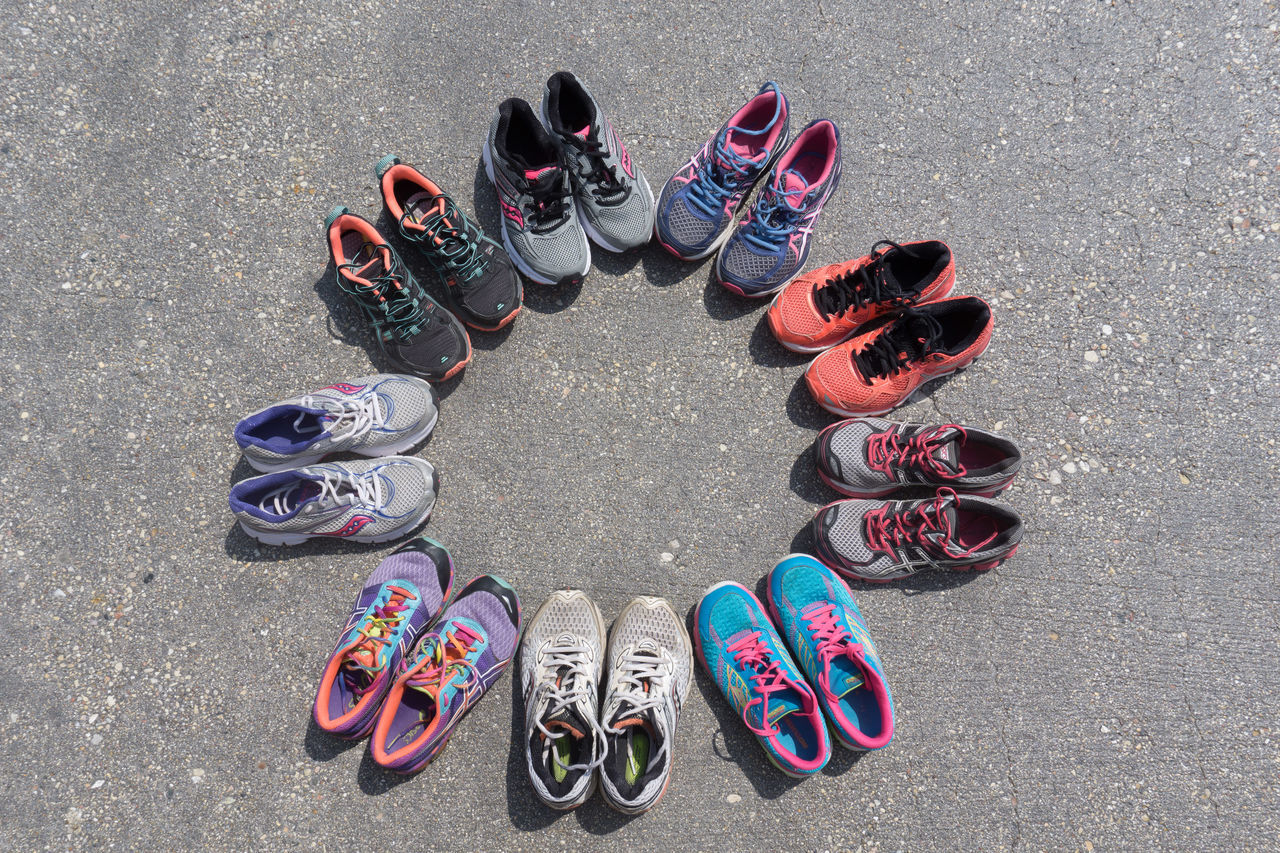 healthy circle of old and new running shoes Day Directly Above Fashion High Angle View Large Group Of Objects Many Miles Multi Colored No People Old To New Out Of The Box Outdoors Pair Runing Shoes Shoe Things That Go Together Togetherness Variation