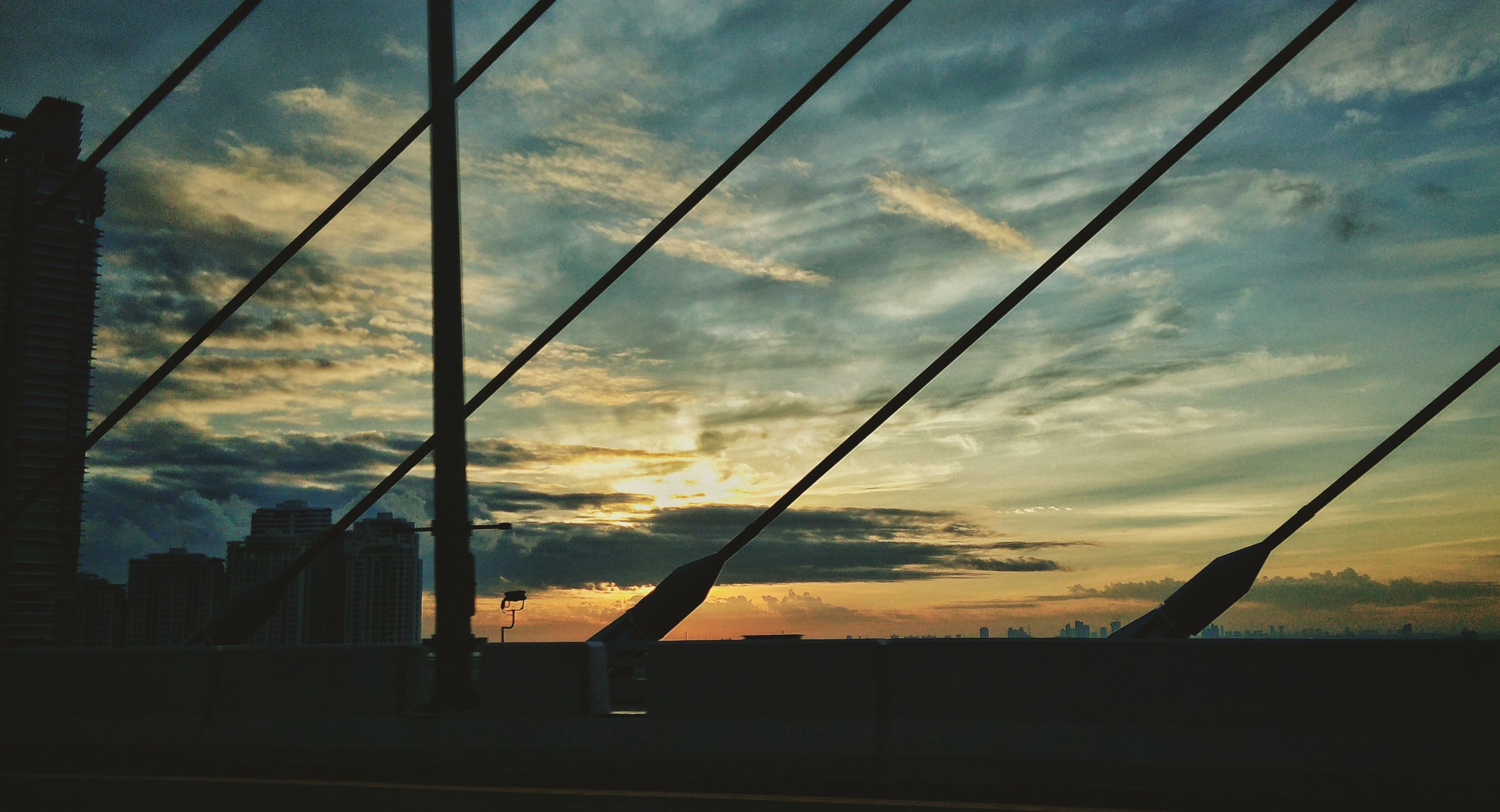 sky, sunset, cloud - sky, built structure, architecture, low angle view, connection, power line, cloud, cable, cloudy, orange color, no people, outdoors, nature, power supply, beauty in nature, weather