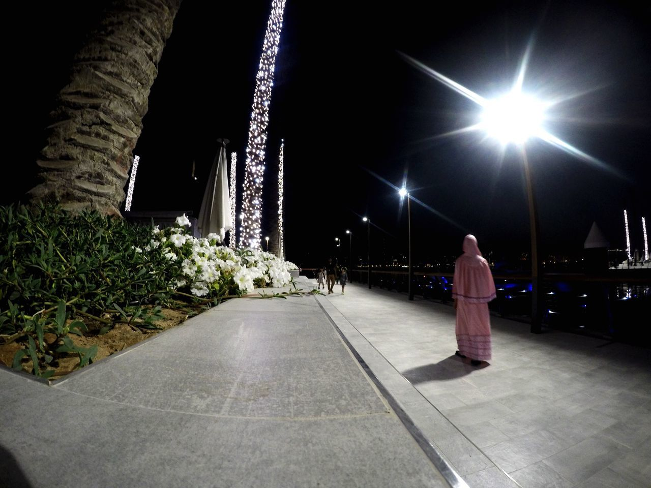 night, illuminated, rear view, real people, full length, standing, indoors, one person, people
