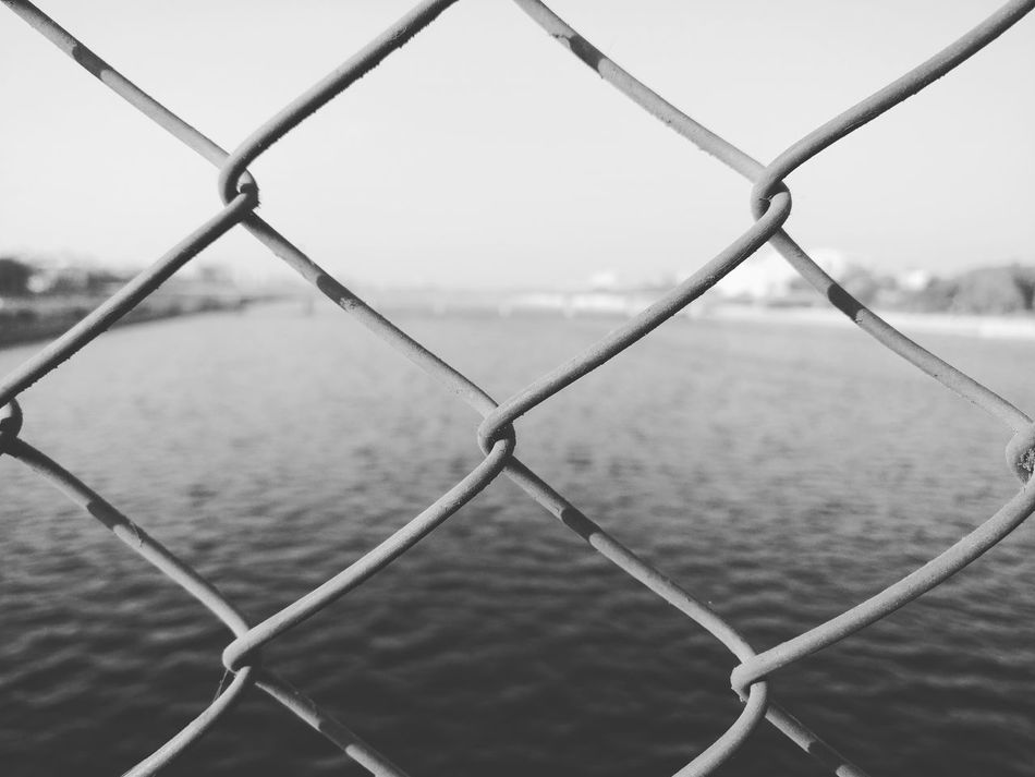 Fence No People Outdoors Water Backgrounds Nature Close-up Sky Day Metal Safety Mobilephotography Oneplus3 Shotononeplus behind the metal grill