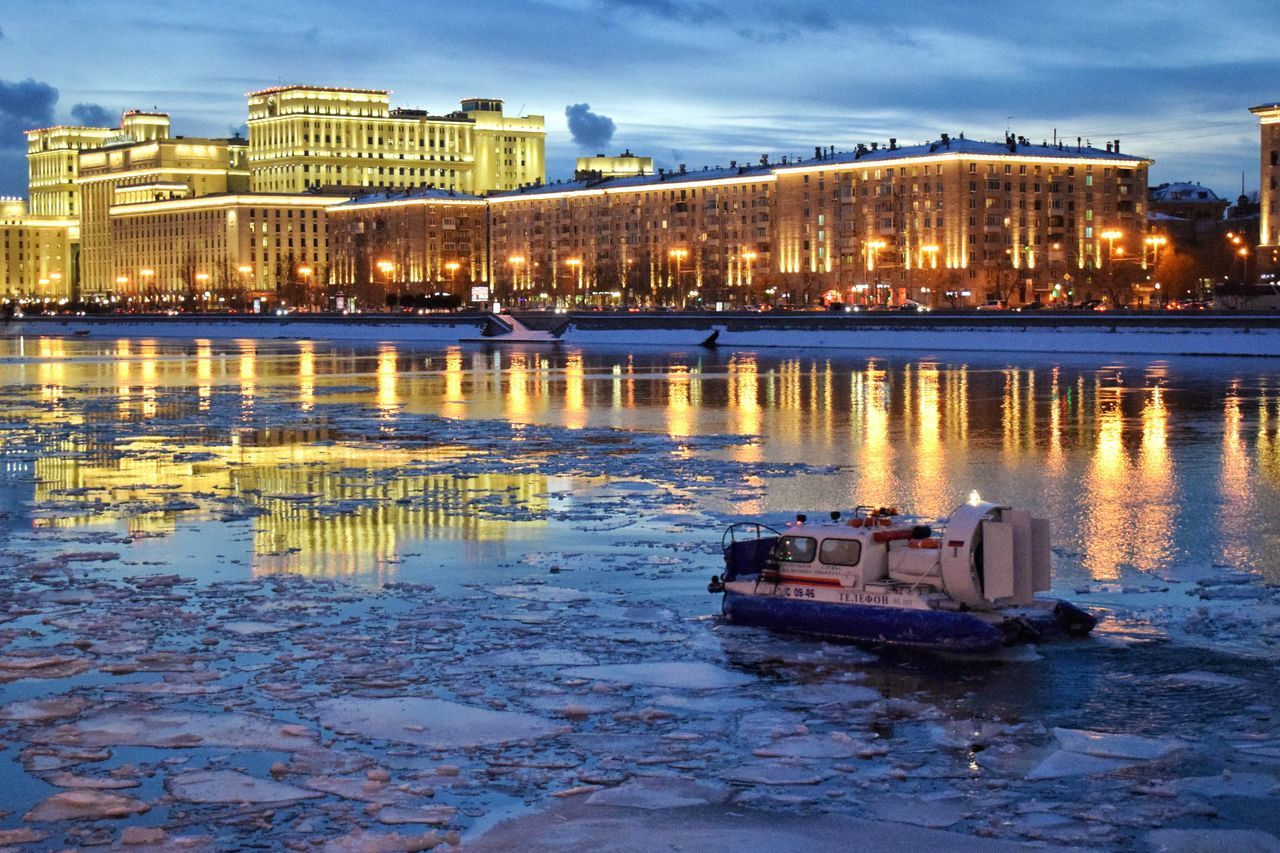 Waiting Game Architecture Building Exterior Built Structure City Winter Water Illuminated Sky River Outdoors No People Snow Night Ice Frozen River Winter Streetphotography Architecture Reflection Boat Water Reflections Nightphotography City Lights Night Lights