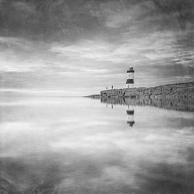 Fish for Tea Reflection Lighthouse Wales Penmon Horizon Over Water Monochrome Photography Tranquil Scene Nature Seascape Sea And Sky Seaside Reflections Fisherman Fishing Outdoors Scenics Idyllic Landscape Nature Photography Architecture Landscape_photography Long Exposure Mextures Bw Photography BW Landscape