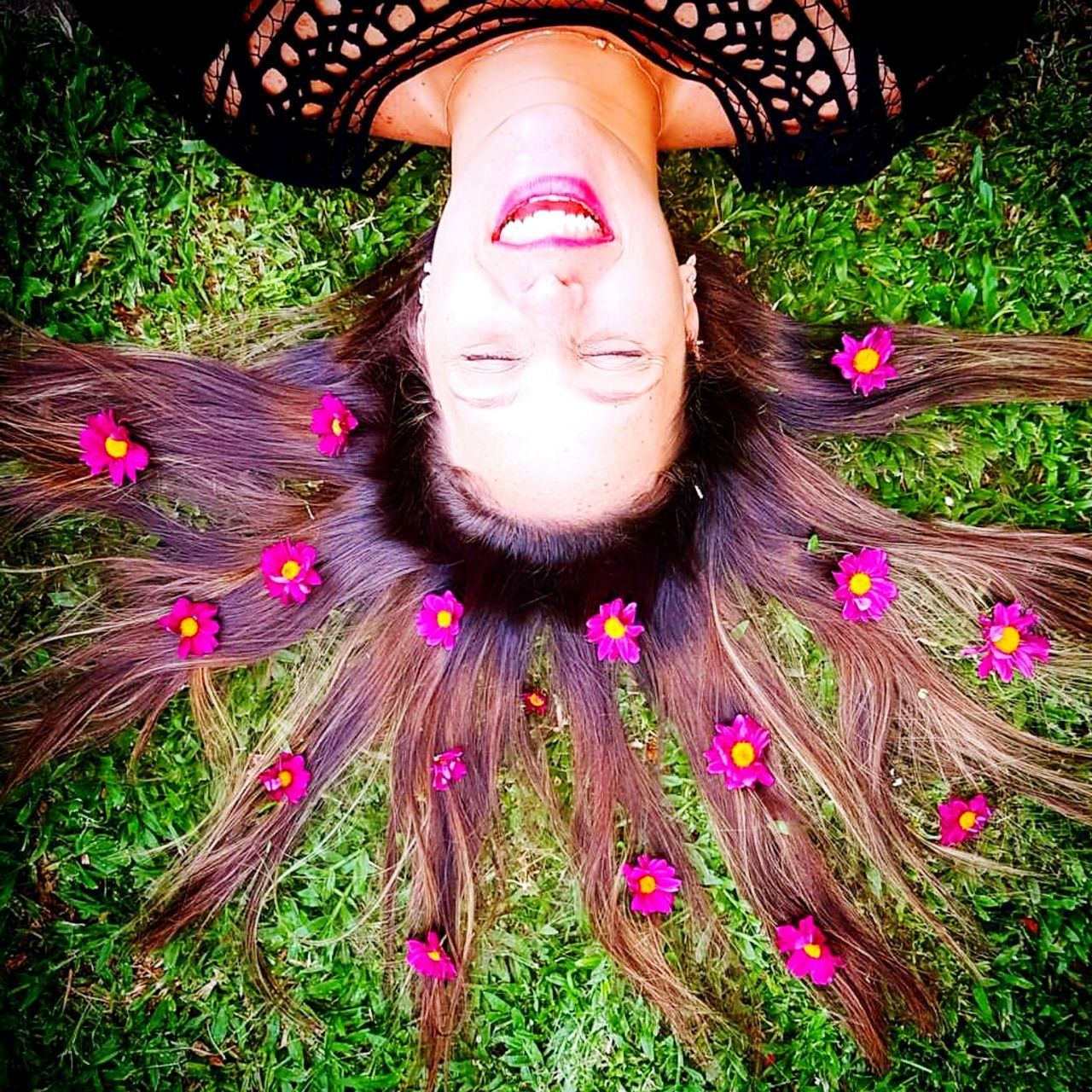 flower, one person, young adult, eyes closed, beauty, one young woman only, lying down, beautiful woman, one woman only, real people, lying on back, young women, only women, nature, adult, headshot, grass, lifestyles, portrait, human body part, people, relaxation, outdoors, human face, beautiful people, freshness, adults only, women, fragility, happiness, beauty in nature, close-up, day, flower head