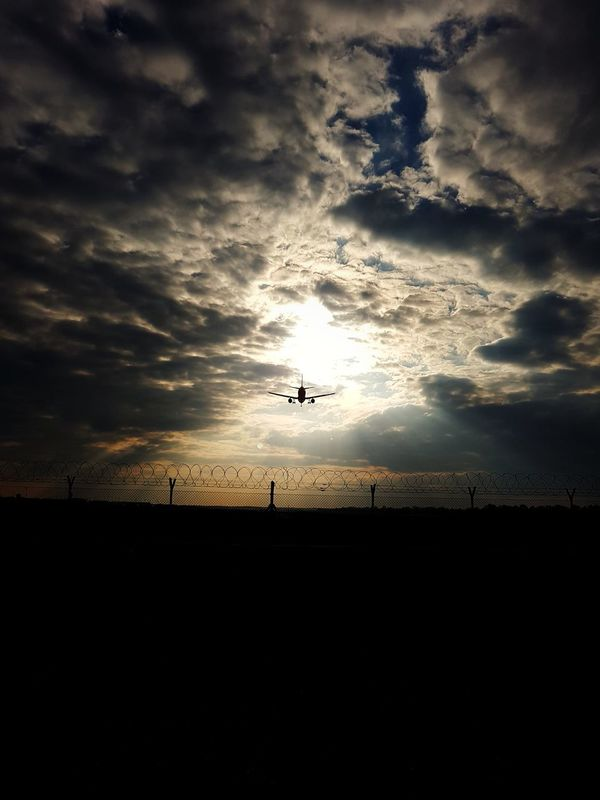 Sunset Flying Silhouette Cloud - Sky Landscape Sky Nature Outdoors Scenics No People Day Airportphotography Travel Destinations Flying High Landing Approach Intothesun