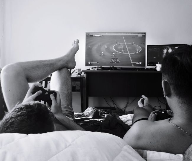 Studeny chilling Sunday afternoon. Domestic Life Indoors  People Two People Adults Only Sitting Television Set Real People Friendship Gameing Blackandwhite EyeEmNewHere Be. Ready. Black And White Friday
