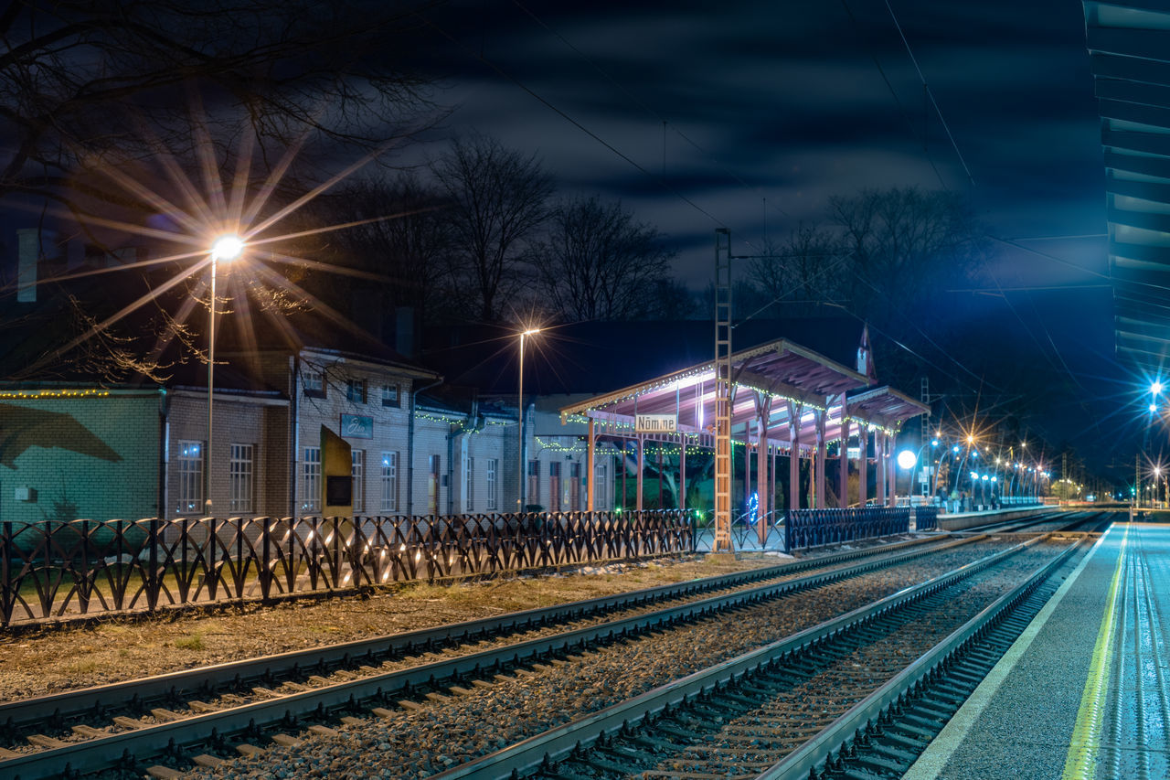 Architecture Building Exterior Built Structure Illuminated Lighting Equipment Mode Of Transport Night No People Nõmme Outdoors Rail Transportation Railroad Track Railway Platform Railway Track Sky Tallinn Transportation