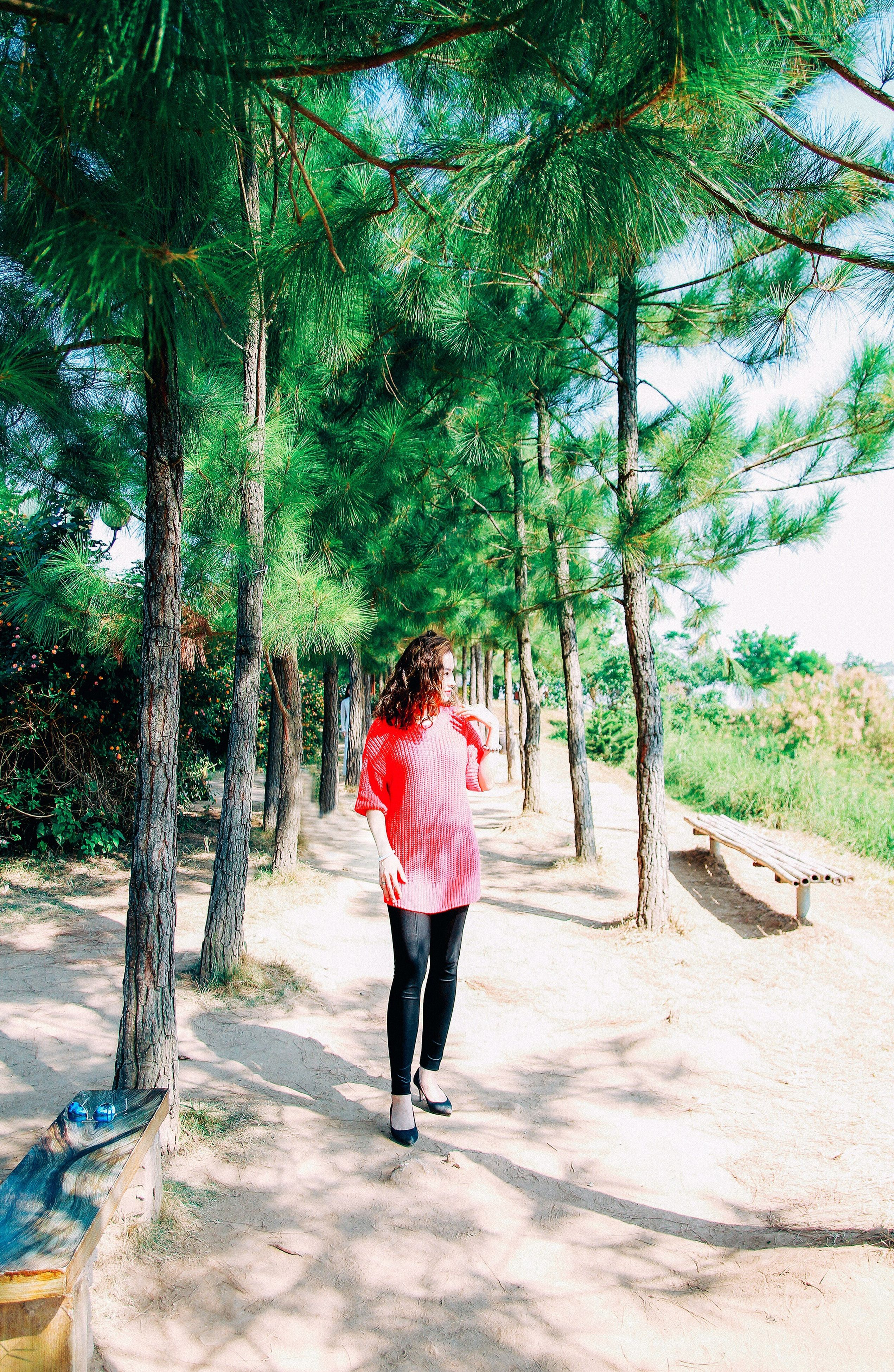 tree, full length, one person, nature, outdoors, leisure activity, day, red, sunlight, growth, real people, people, one woman only, one young woman only, beauty in nature, young adult, adults only, adult