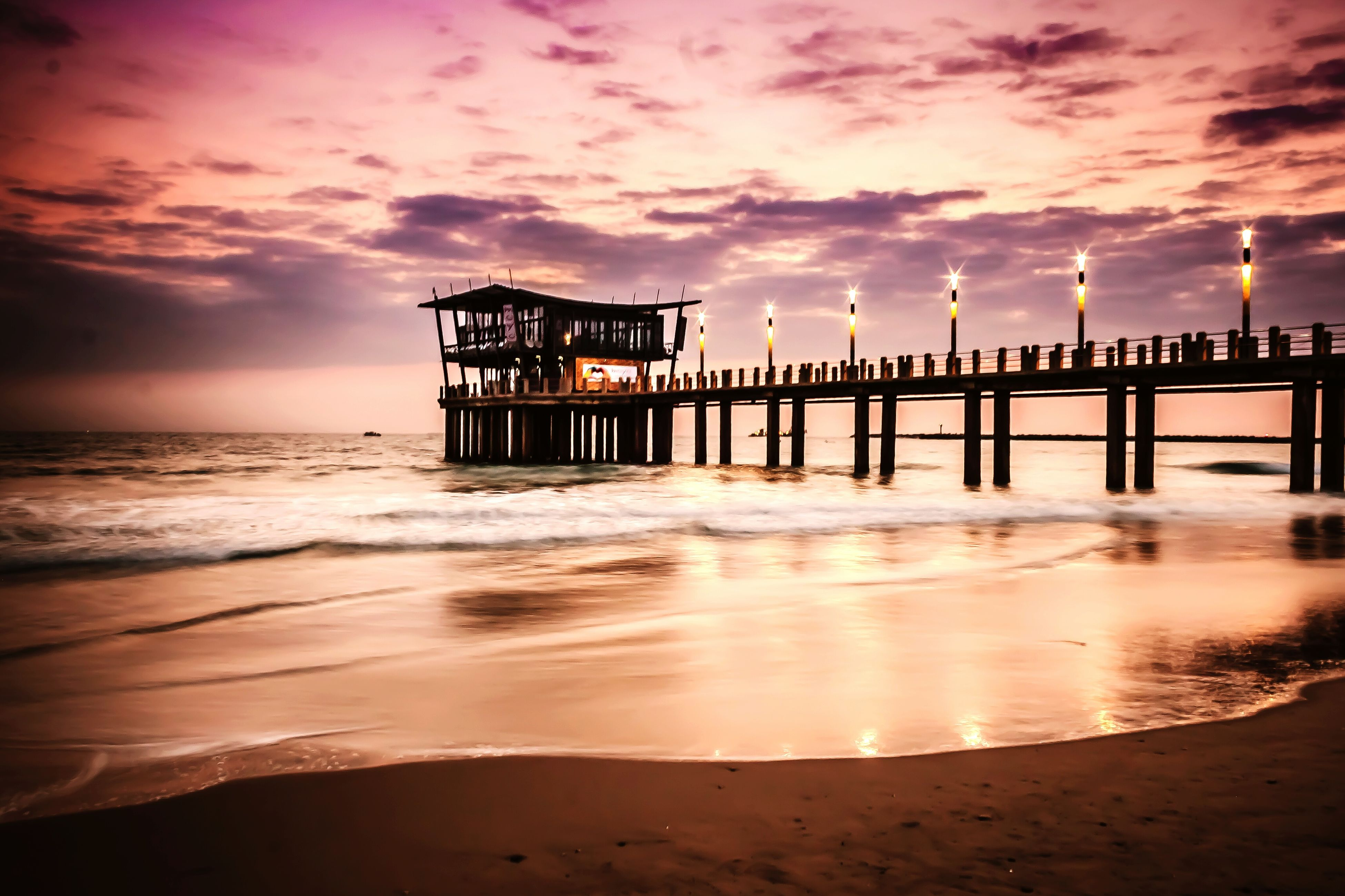 sea, water, beach, sky, sunset, horizon over water, shore, cloud - sky, built structure, sand, scenics, architecture, tranquil scene, tranquility, pier, beauty in nature, wave, nature, dusk, cloudy