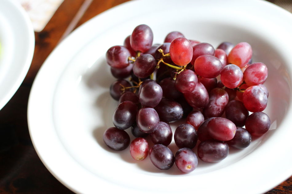 Grapes on a plate Bowl Close-up Day Focus On Foreground Food Food And Drink Freshness Fruit Grape Grapes Healthy Eating High Angle View Indoors  Large Group Of Objects No People Plate Ready-to-eat Table